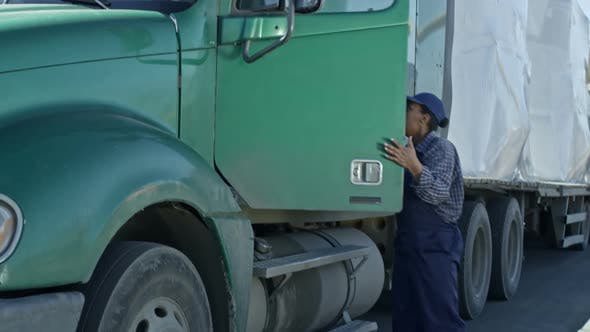 Thumbnail for African Female Driver Leaving Truck