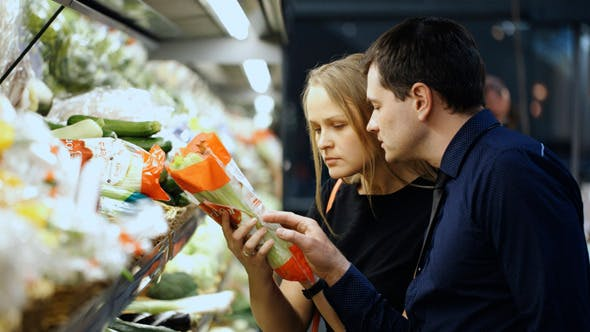 Thumbnail for Man And Woman Buying Fresh Vegetables In Grocery