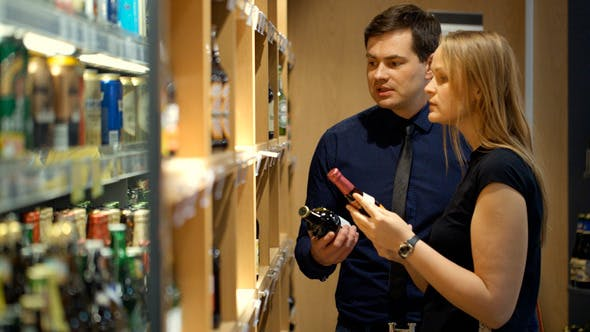 Thumbnail for Young Couple Choosing Wine In The Shop