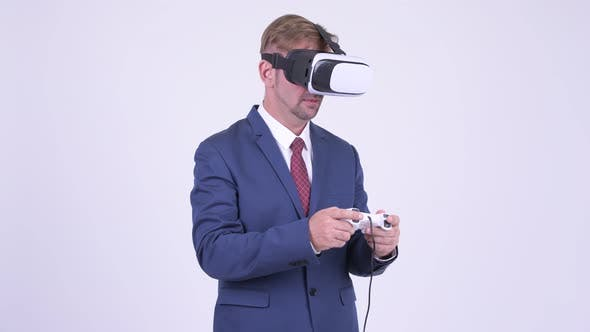 Thumbnail for Blonde Businessman Playing Games and Using Virtual Reality Headset