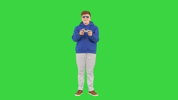 Thumbnail for Teenage Boy Playing Videogames and Winning on a Green Screen, Chroma Key.