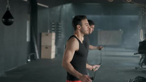 Athletes Jumps on Skipping Rope. In Sports Hall or Gym.  Slow Motion