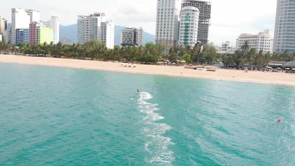 Aerial View of the City Beach and Active People Practicing Kite Surfing and Windsurfing. Kitesurfing