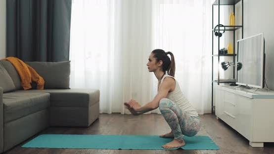 Thumbnail for Young Woman Doing Yoga at Home. Healthy and Sport Lifestyle