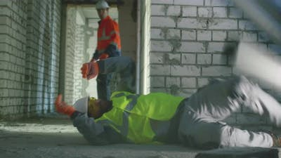Builder Saving Colleague After Accident