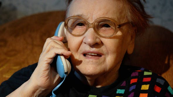 Thumbnail for Elderly Woman In Glasses Taking A Call