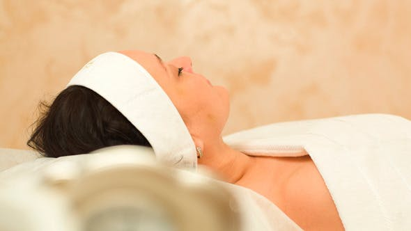 Massage Therapy Of Womans Face At Beauty Spa