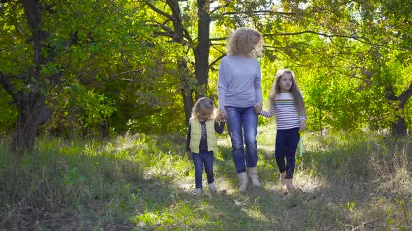 Thumbnail for Happy Caucasian Family Strolling in the Autumn Park