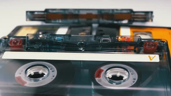 Thumbnail for Four Audio Cassettes Rotate on White Background