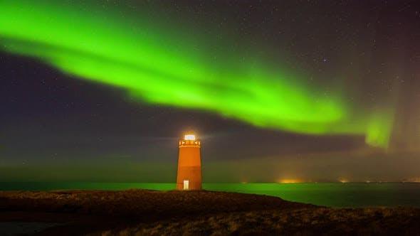 Cover Image for Lighthouse on Reykjanes Peninsula Under Nortern Lights. Iceland
