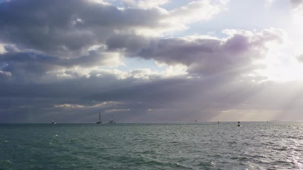 Thumbnail for Ocean with boats on a cloudy evening