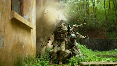 Military men in action, slow motion