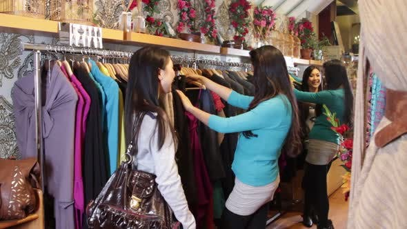 Thumbnail for MS, Females looking in clothes shop at clothes