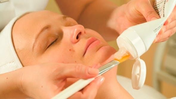 Applying Facial Mask In Beauty Treatment Salon