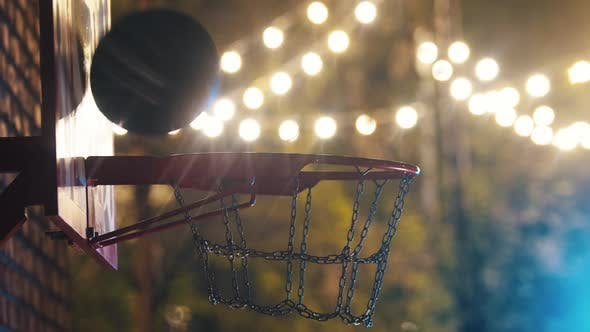 Thumbnail for Basketball Ball Getting in the Hoop on Outdoor Playground at Night