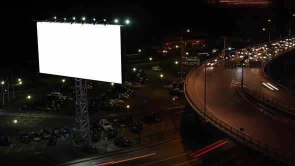 Timelapse Shot of Night City. Car Traffic and Blank Banner in the Street