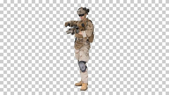 Thumbnail for Soldier in camouflage gear checking his uniform, Alpha Channel