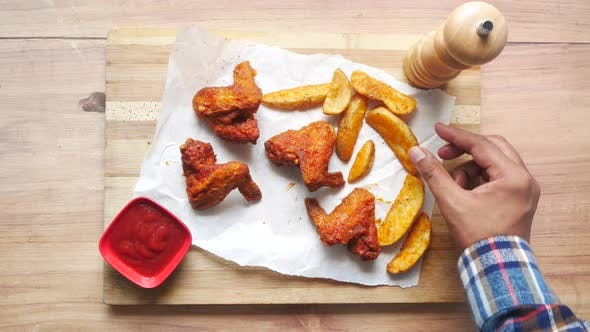 Grill Chicken and Sweet Potato Wedges on a Board