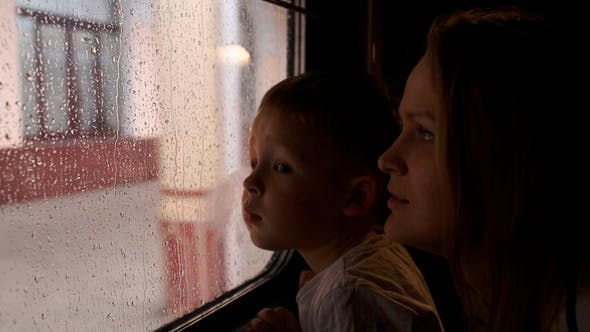 Thumbnail for Mother And Son In The Train Looking Out The Window