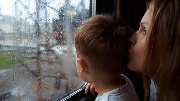 Thumbnail for Boy And His Mother Looking Out The Window Of Train