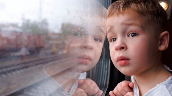 Thumbnail for Curious Boy Looking Out Of The Train Window