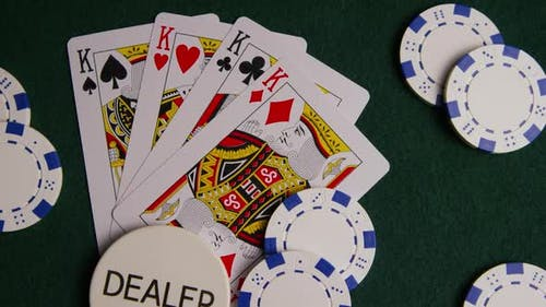 Rotating shot of poker cards and poker chips on a green felt surface - POKER 014