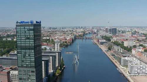 Aerial View of Spree River at Treptower Building Complex and Molecule Man Sculpture on Water