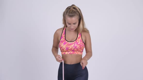 Thumbnail for Happy Young Blonde Woman Measuring Waist and Giving Thumbs Up