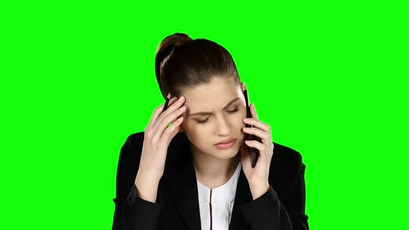 Cover Image for Businesswoman Under Stress Speaking at the Phone, Green Screen
