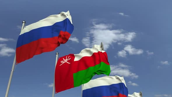 Flags of Oman and Russia at International Meeting
