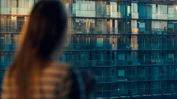 Thumbnail for Woman Opening The Blind And Looking At The City