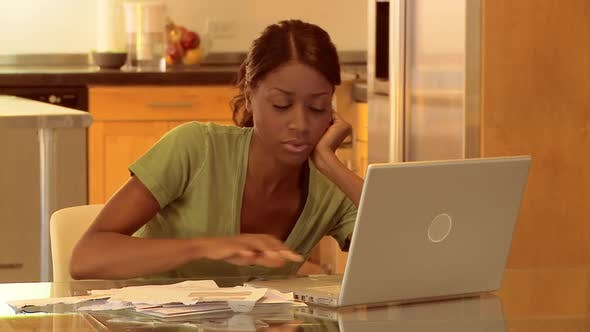 Thumbnail for Young woman unhappy while working on laptop at home