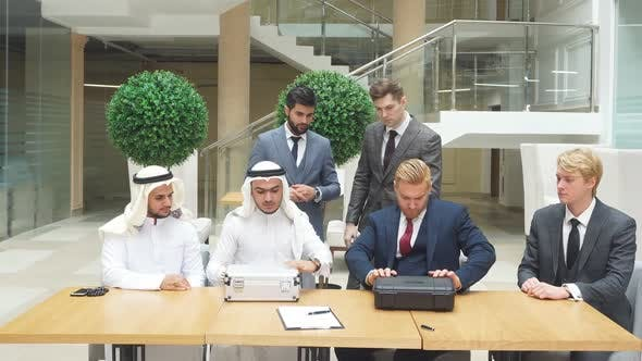 Meeting of International Business Partners in Office for Signing New Document