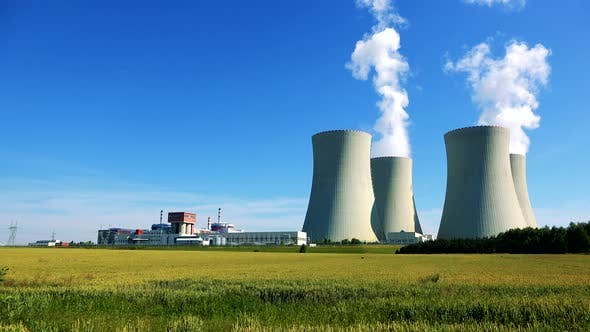 Thumbnail for Factory (Nuclear Power Station) - Closeup of Buildings and Smoke From Chimney - Field with Plants