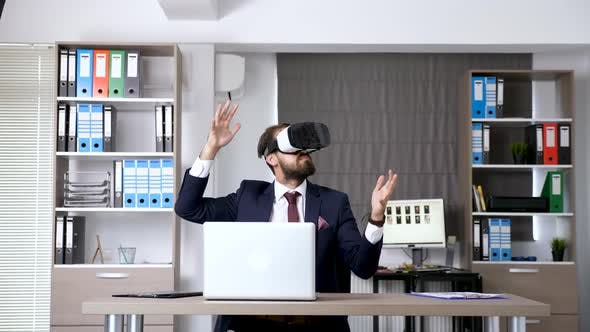 Thumbnail for Revealing Dolly Slide Shot Businessman in Start Up Office Company Working with VR Goggles