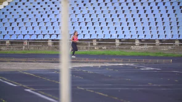 Thumbnail for Girl Running at the Stadium