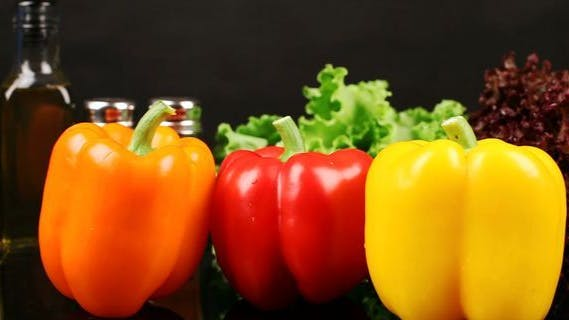 Thumbnail for Three Varieties of Peppers On Dark Table