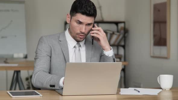 Thumbnail for Negotiation, Businessman Talking on Phone