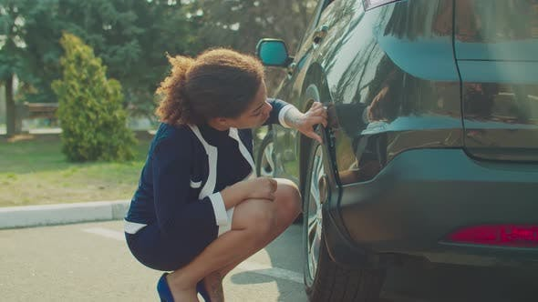 Thumbnail for Helpless Woman Looking at Damaged Scratched Car