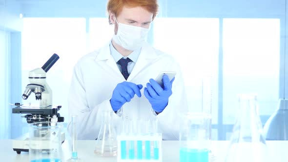 Thumbnail for Scientist Using Smartphone in Laboratory