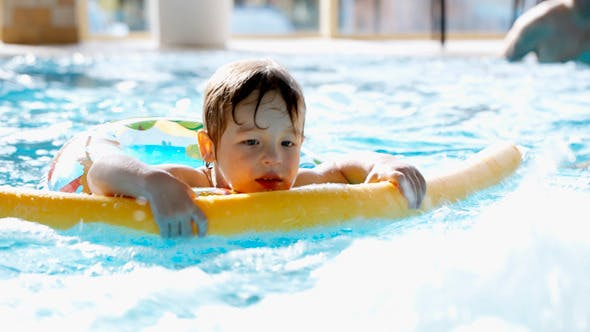 Thumbnail for Little Boy Swimming In The Pool With Rubber Ring