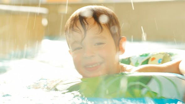 Cover Image for Happy Little Boy Swimming With Rubber Ring