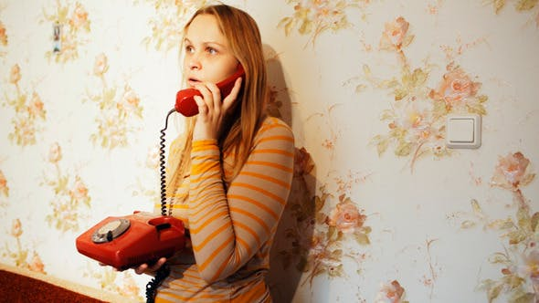 Cover Image for Young Woman Talking On The Phone At Home