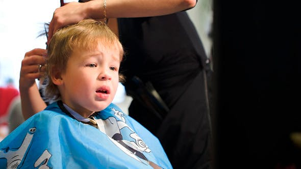 Thumbnail for Boy Taking Off The Cape While During Haircut