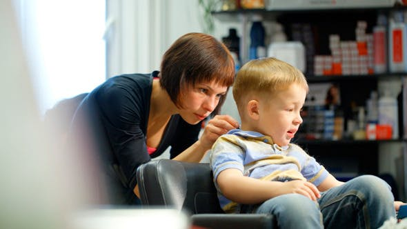 Thumbnail for Little Boy During Haircut At The Hairdressing