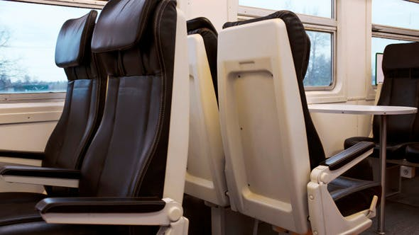 Thumbnail for Empty Black Seats In Moving Express Train