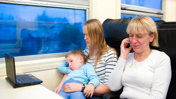 Passengers In The Train Watching Video On Laptop
