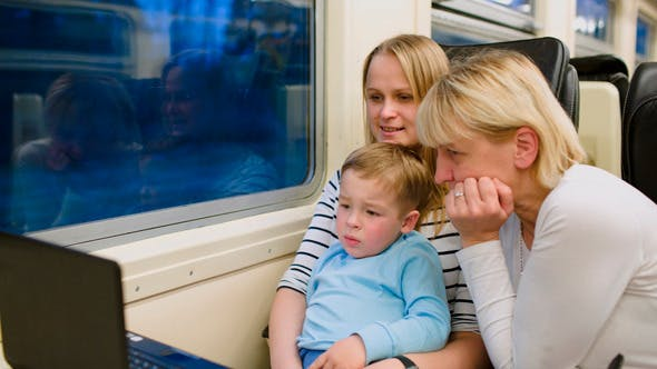 Thumbnail for Family With Child In The Train Watching Video
