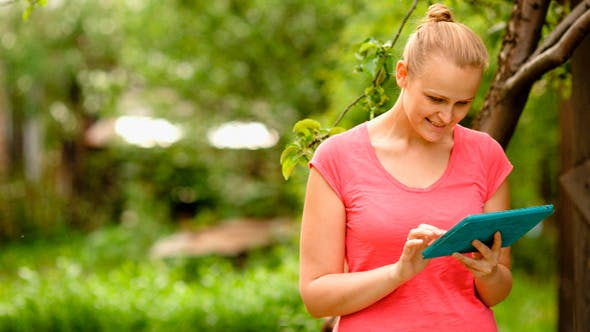 Thumbnail for Woman Working With Tablet Pc Outdoor