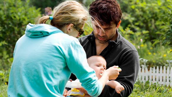 Thumbnail for Young Parents Feeding A Baby Boy Outdoor